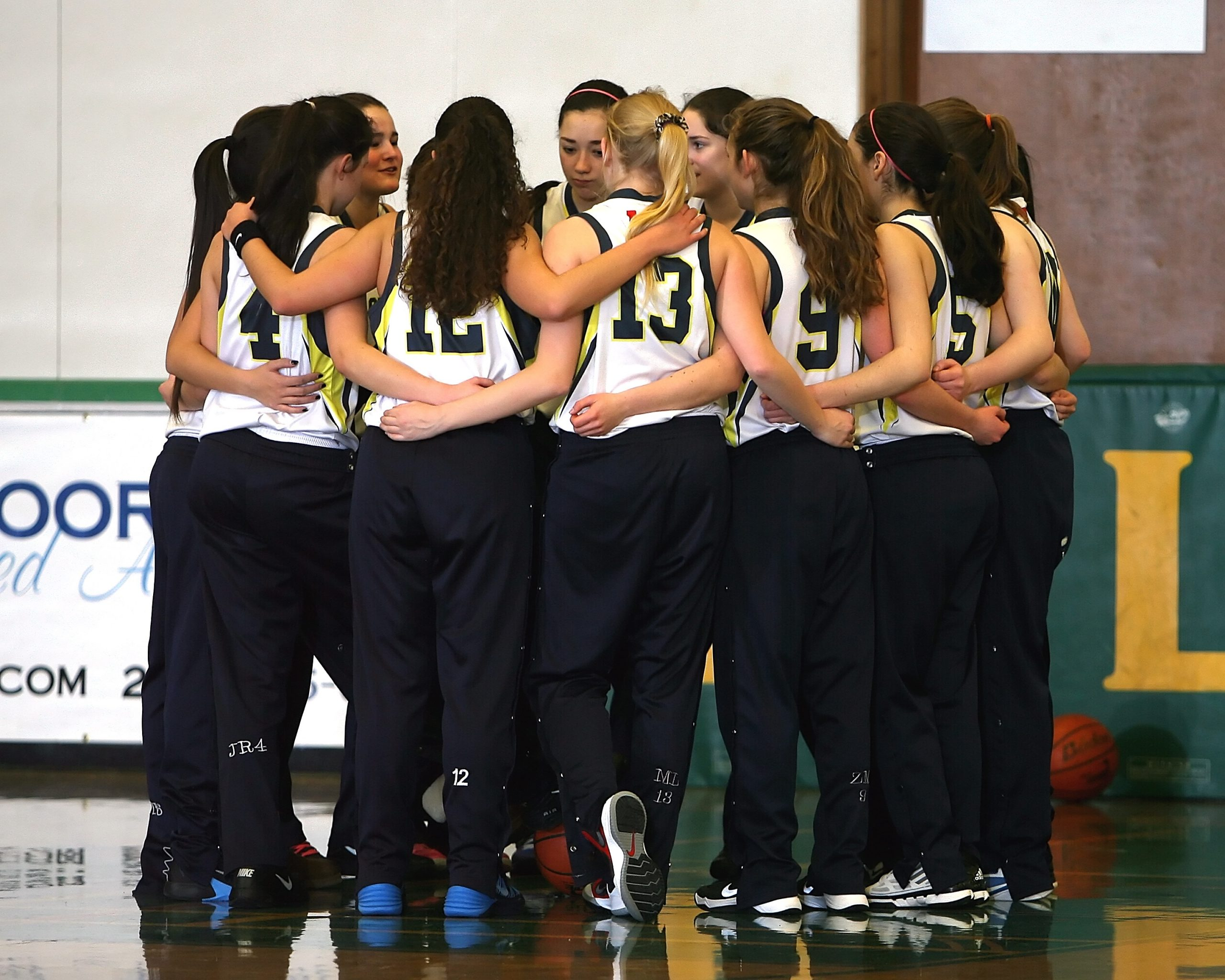 Womens basketball team in a huddle